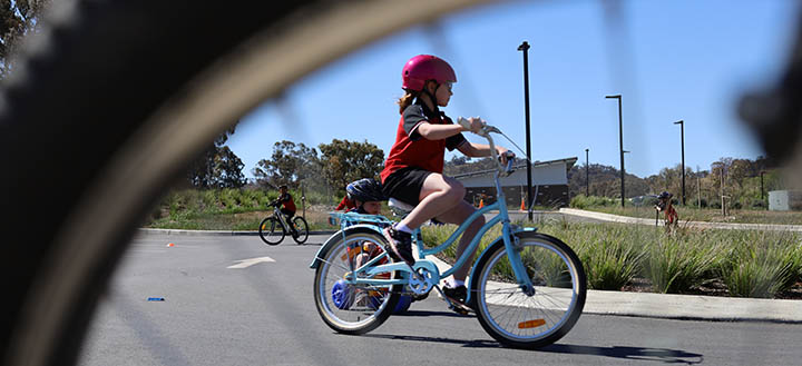 Student riding a bike.